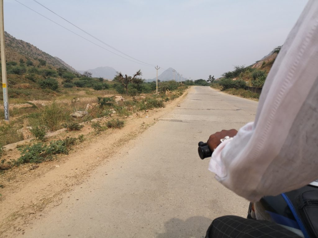 On the back of the motorbike with Ram - Pushkar