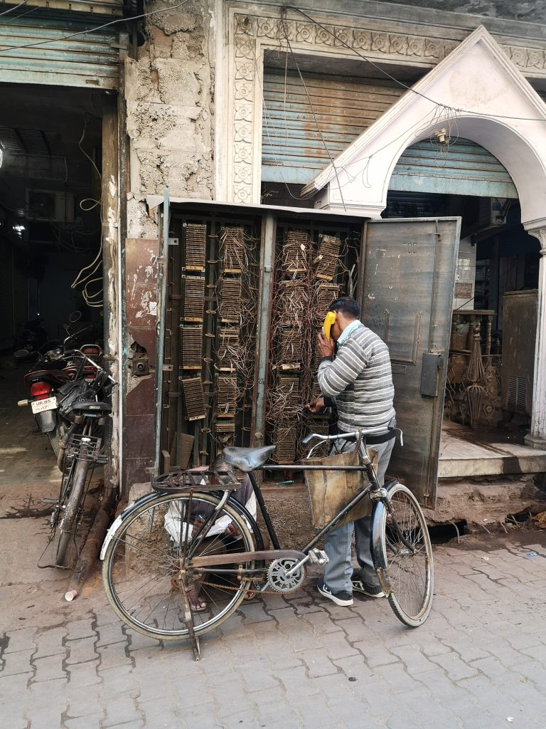 Fixing a telephone problem in the streets of Mathura
